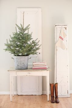 A small tree and a single stocking give the perfect backdrop to a minimalist Christmas.