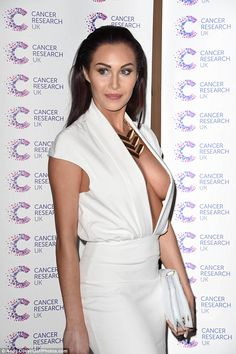 9730f4a63fc64 Showing off her sideboob  Chloe Goodman wore a risky white plunging dress  at the Jog