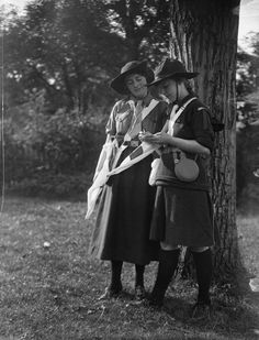 Girl Guides confer during an exercise in flag communications in the United Kingdom during the First World War. 1914.
