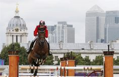 what a view: Canada's Tiffany Foster rides Victor during the equestrian individual jumping first qualifier in Greenwich Park at the London 2012 Olympic Games August 4, 2012.