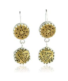 Double drop filigree vintage button earrings set in silver by Harvey and Quinn.