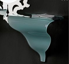 ices I Wall Console. Table is made of 12 mm satin glass. It is provided with a white solid wood support.