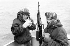 Warming mugs of tea for Royal Marine Jeff Phipps 19 of Bucknall, Stoke on Trent and Rick Carr-Hyde, 19 of Aston, Bristol at their action station aboard HMS Hermes with the Falklands task force Get premium, high resolution news photos at Getty Images