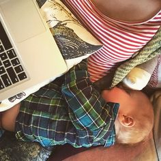 Many moms wonder how I get anything done throughout my day as a mompreneur! This photo captures a bit of what it's like for this #mom blogger. Making it work and making it sweet with the help of my #love #baby.