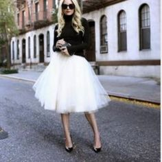 White tulle skirt Super chic and pretty. Fluffy and comfy, no itchy. Elastic waist band. S: waist 24 inches can be stretched 41 inches. M: 26 inches can be stretched to 43, L: 27 can be stretched to 45 inches. XL: 28 can be stretched to 47 inches Skirts Midi
