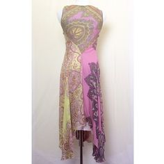 NWOT Odille silk boho dress Absolutely beautiful sheer silk maxi with pink slip underneath and hanky style hem. My pics do not do this beauty justice! Rich and gorgeous pink, purple, orange and green paisley / mandala patterns throughout. Never worn. Anthropologie Dresses
