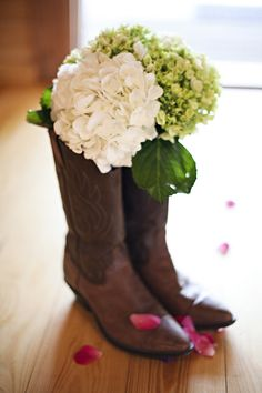 Super cute and classy idea for a country wedding! Two of my favorite things together: hydrangeas and boots! :)