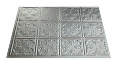 """This Fasade backsplash panel Traditional 10 in Argent Silver features a stylized lily, or """"fleur-de-lis"""" pattern, which represents old-world monarchy and provides a subtle sense of grandeur. Our Argent Silver finish is perfect for homeowners looking for a bit of softness. Cool, matte silver is a sophisticated choice for a contemporary look."""