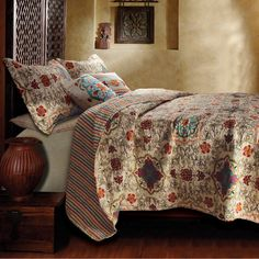 Cotton quilt set with medallion motif and daisy-chain stitching. Includes two decorative pillows.   Product:    Full/Quee...