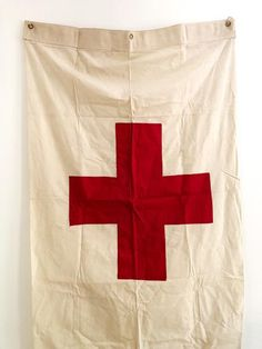 large war era red cross or medic flag. patina soft white cloth construction with stitched red cross. Vintage Flag, Vintage Keys, Cross Flag, Red Cross, California Flag, Playing Doctor, Medical Symbols, Band Of Brothers, Vintage Medical
