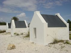 You're looking at slave huts built in Bonaire in the 1850′s. You can find them astride the coastal EEG Boulevard near Bonaire's Salt Lake along the southwest coast of the island.