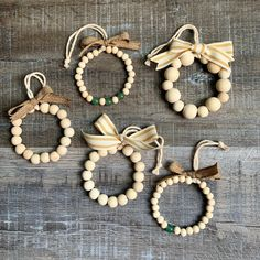 Mini Farmhouse Wood Bead Wreath Ornaments Hi friends, I have a little Christmas in July for you today! These Mini Farmhouse Wood Bead Wreath Ornaments are so fun and easy to make. I found the tutorial here at eHow – it has step by st… Wood Bead Garland, Beaded Garland, Beaded Ornaments, Diy Christmas Ornaments, Homemade Christmas, Holiday Crafts, Wood Wreath, Wood Ornaments, Christmas Decorations