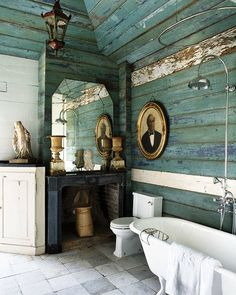 love this clawfoot tub with the shower ring with the rain making spout