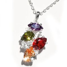 £5.00 Avon Dare to Dazzle Pendant Neclace.  Elegant, Silver-plated necklace, approx. 42cm + 9cm. and pendant, approx. 2.7cm x 1.7cm, set with coloured and clear cubic zirconias.