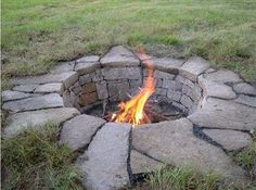 A fire pit that is actually a pit - love it! Made with natural stone and flagstone.