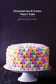 """We've got all kinds of """"oven"""" for this adorable conversation hearts cake!"""