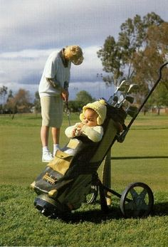 """Golf bag/baby stroller:  """"Now sweetie, if you don't watch me, you'll never learn to play golf!"""""""