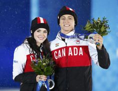 Silver medallists Canada's Tessa Virtue and Scott Moir celebrate during the medal ceremony for the figure skating ice dance free dance program at the 2014 Sochi Winter Olympics February 18, 2014. REUTERS/Shamil Zhumatov (RUSSIA - Tags: OLYMPICS SPORT FIGURE SKATING)