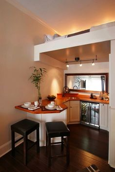 Why do I see so many lofts without a rail? Nevertheless, very pretty and efficient>>>Beautiful Small Kitchen with Upstairs Sleeping Loft