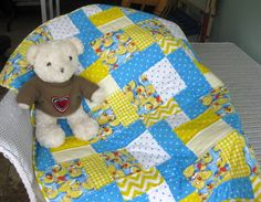 Rubber Duckie Blues - one of those perfect baby quilts for boys. http://shop.uniquebabyquiltboutique.com/