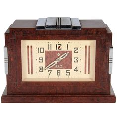 Art Deco Skyscraper Style Jaz Clock in Bakelite and Chrome | From a unique collection of antique and modern clocks at https://www.1stdibs.com/furniture/more-furniture-collectibles/clocks/