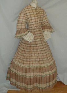 "1840-50 cotton print dress; ebay seller fiddybee; fabric- blue, gray & red floral print; piping at neck, armscyes & waist; bodice lined with linen, hook & eye closurem cartridge pleating; unlined skirt; hem has 19"" mend; bust: 36' waist: 26""; skirt length: 40; hem width: 160"""