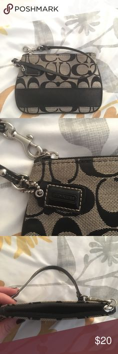 COACH black wristlet Authentic coach wristlet, small, fits credit cards, lipsticks, femme products. Tight fit with an iPhone 6 with case. Perfect to throw in a large bag or just to bring along going out to the bar or stores. Bags Clutches & Wristlets
