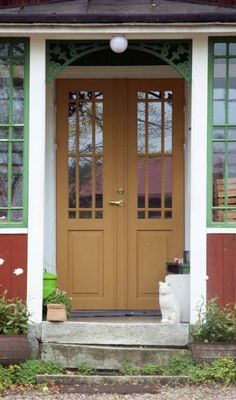 Check out this great metal garage doors - what an original style Metal Garage Doors, Garage Door Design, Stairs And Doors, Porch Entry, Red Cottage, Swedish House, Exterior Doors, Doorway, Garden Gates