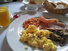 American breakfast (scrambled egg, bacon, baked beans and fresh mushrooms) with assorted bread basket (toast, croissant, bread of the day) and fresh orange juice. Cafe 55, Muntri Street, Penang.