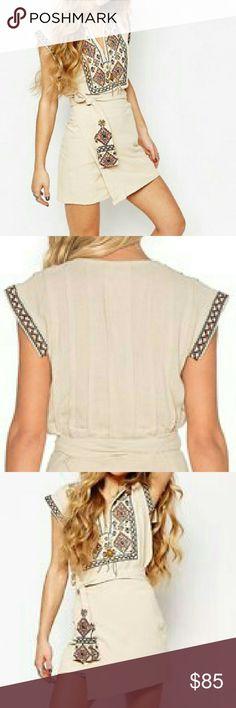 Free People Mini Dress NWT Free People mini wrap dress with embroidery detail. 100 % cotton. Free People Dresses Mini