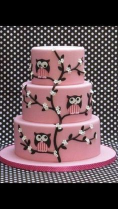 Three tier pink owl cake with cherry blossoms