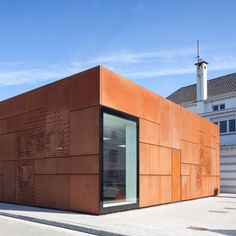 Studio Farris linrary extention in Bruges - corten + white plaster