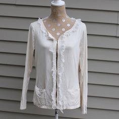 "Badgley Mischka cream cardigan Beautiful Badgley Mischka cream cardigan. Front closure is hook and eye and is edge is clear beads and cream silk. Has two pockets in the front. No noted stains or rips. Size medium    Length: 23.5"" (shoulder to back hem) Sleeve length: 23"" Bust: 18"" (font labels touching) Shoulders: 15.5"" Badgley Mischka Sweaters Cardigans"