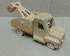 "This essential vehicle is important for moving toys from one end of the room to the other. It can handle anything that is loaded and strapped down. The stake bed sides are removable. Project is about 11 ½"" long. All parts can be made from standard ¾"" thick lumber. Purchase is the plan only. All drawings can be printed on 8.5 x 11 paper"