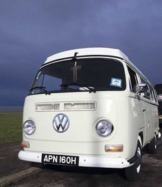 The storm clouds gave a very dramatic backdrop to a vintage VW L87 Pearl White Early Bay Westfalia
