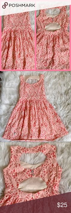 Kiddo by Katie Gil's lace dress Kiddo by Katie girls lace dress. 2 peek a boo backless cut outs with rhinestone buttons zippers in back. Lining on inside. Dress is coral and white lace. In excellent condition worn once. Kiddo by katie Dresses