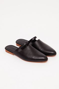 If you're tired of basic flats and impractical heels, take a walk in these elegantly understated leather slippers. The softly pointed almond toe gives the humble slide a refined air while a cut-out al