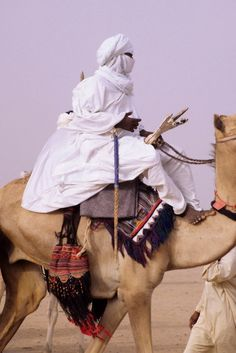 In-Gall, near Agadez, Niger - Tuareg Man Riding Camel, with Camel Saddle and Decorations Visible. Camel has red leather talisman around his neck. COPYRIGHT:© Charles O. West Africa, North Africa, Tuareg People, Desert Sahara, Turbans, Folk, World Cultures, People Around The World, Traditional Outfits