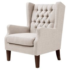 This upholstered armchair brings modern flair to any room in the house, with tapered legs and an espresso finish that provides understated style to match a variety of decorative tastes. The Maxwell tu