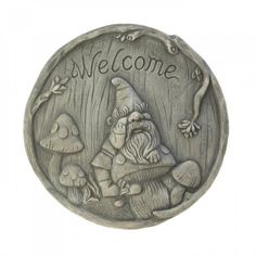 Welcome Gnome Stepping Stone - This bearded gnome is ready to welcome you each time you set foot in your garden or yard. This charming stepping stone is made from cement and features a wooded scene complete with a bunch of mushrooms and a friendly gnome.