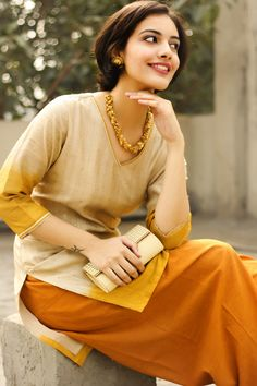 beige kurti paired with a plain turmeric coloured salwar. Indian Attire, Indian Ethnic Wear, Pakistani Outfits, Indian Outfits, Estilo India, Desi Wear, Fashion Themes, Desi Clothes, Kurta Designs