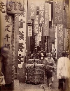 "Ah Fong, ""Canton, China, Street Life"", ca. 1870 -- This was the China my grandfather's family knew before coming to America.  Back then, the men had to go to America alone.  Chinese brides were smuggled into North America (often through Canada).  I have heard them referred to as paper daughters, because people would give their paperwork to help smuggle women before they could immigrate from China legally."