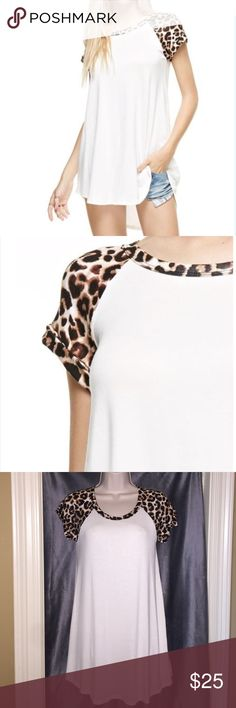 """Hi low raglan tunic White and leopard print hi low raglan tunic. Sleeves are cuffed once. Length in front from collar to hem is 26"""". Length from top to bottom in back is 31"""". Very soft. 95% rayon 5% spandex. Lollipop star Tops Tunics"""