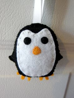 felt penguin ornament - for the boys fair penguins ... maybe instead of buying one for each of them I could make them?