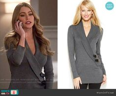 Gloria's grey buckled wrap cardigan on Modern Family.  Outfit Details: https://wornontv.net/56592/ #ModernFamily