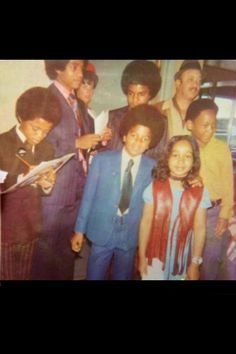 Michael Jackson, his brothers, and a fan - Jackson 5 Era