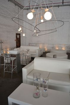 Shaker | Something Different | Industrial Decor, simple white sofas, wire lampshades, metal furniture, paper art