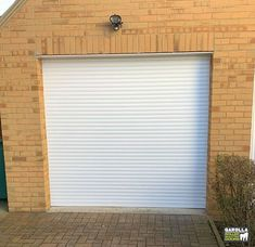 Electric garage doors allow you to enter your garage in style as well as ease. With a garage door from our selection of roller doors you can enter your garage in ease. Click the link to see our electric roller garage door range.  #whitedoor #whitegaragedoor #whitegaragedoors #whitehome #whitegarden #whiteexterior #whiteinterirdesign #whitegarden #whitegaragedoorideas #whitegarage