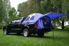 Camping with my new 2013 Nissan Frontier~  Got to get this for my new red truck!!