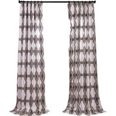 Frame a window in the living room or master suite with these boldly patterned cotton curtains, showcasing an ikat-inspired design in gray and white.
